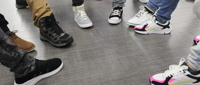 Students pose with their new shoes