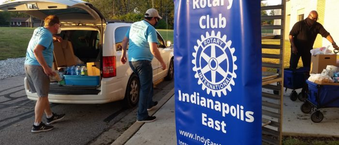Members load food into vehicles at the October distribution at Sonny Day Warren Township